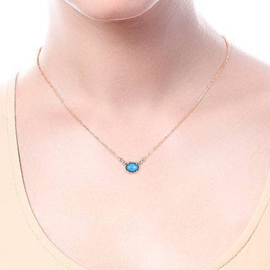 Wearing a Rock Crystal Turquoise & Diamond Necklace in 14k Rose Gold