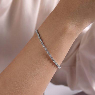 Wearing the Lusso Alternating Diamond Tennis Bracelet in 14k White Gold